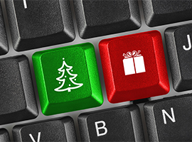 Keyboard with a green christmas tree key and a red gift key