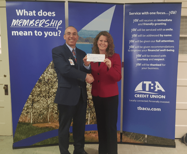 Paul Soma and Karen Browne with the 2017-18 TCAPS Donation